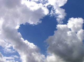 Heart in the clouds above Schiphol airport, Amsterdam